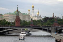 Moscow Kremlin panorama. Cruise ships sails on the river. Moscow Kremlin is a UNESCO World Heritage Site. Blue sky background Stock Images