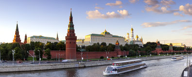 Moscow Kremlin. Panorama - Moscow Kremlin at summer evening. Moscow-river and tourist pleasure boats. View from bridge Royalty Free Stock Photos