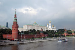 Moscow Kremlin panorama in a sunny day. Cruise ship sails on the Moscow river. Stock Photography