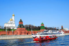 Moscow Kremlin panorama, two ships cruise on the river. Moscow Kremlin towers, Ivan Great Bell-tower, Archangel church in a sunny day. The Moscow river Stock Photo