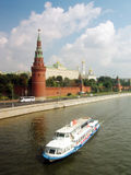 Moscow Kremlin panorama. White cruise ship. MOSCOW - AUGUST 03, 2014: View of Moscow Kremlin. A popular touristic landmark, UNESCO World Heritage Site. Moscow Royalty Free Stock Photography