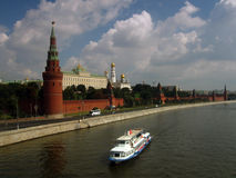 Moscow Kremlin panorama. White cruise ship. MOSCOW - AUGUST 03, 2014: View of Moscow Kremlin. A popular touristic landmark, UNESCO World Heritage Site.  White Royalty Free Stock Photography