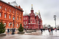 The Moscow Kremlin, People and tourists walking in the Red Square in winter day with the  landscape of The State Historical Museum. Moscow, Russian Federation Royalty Free Stock Images