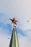 Moscow Kremlin. Red ruby star. Birds flying around. Royalty Free Stock Images