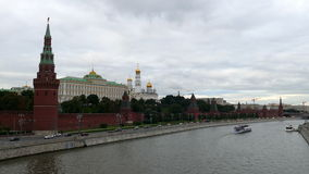 Moscow Kremlin and the river with the ship in stock footage