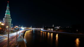 Moscow Kremlin and ships on Moskva river at night. Time-lapse. 4K stock video footage