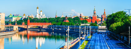 Moscow Kremlin in spring. MOSCOW, RUSSIA - MAY 25, 2015: Panorama of the Moscow river and the Kremlin in the morning. Low traffic along Moskvoretskaya embankment Royalty Free Stock Photography