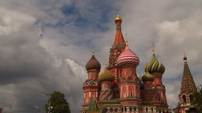Moscow Kremlin, St. Basil Cathedral. Against a background of moving clouds stock video footage