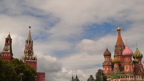 Moscow Kremlin, St. Basil Cathedral and Spasskaya Tower. Against the background of clouds stock video footage