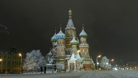 Moscow Kremlin and St. Basil's Cathedral at night. Moscow Kremlin and St. Basil's Cathedral at winter night stock video footage