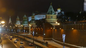 Moscow Kremlin and street cars in the evening - winter stock footage