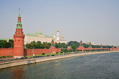 Moscow Kremlin in summer haze during sunset. View from the bridge across Mocsow River Royalty Free Stock Photo