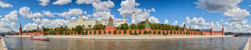 Moscow Kremlin in summer. Panoramic view to Moscow Kremlin from Sofiyskaya embankment over river with ship under clouds, Russia Royalty Free Stock Images