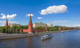 Moscow Kremlin on a sunny day. Panoramic view of the Moscow Kremlin along the quay of the Moscow river royalty free stock photos