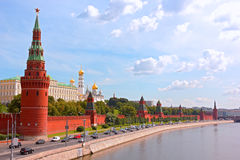 Moscow Kremlin at sunrise. Panoramic view of Moscow Kremlin from Kamenny bridge with Vodovzvodnaya Tower on the forefront Stock Photos