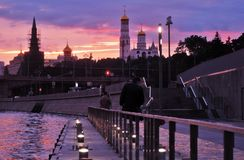 Moscow Kremlin at sunset and the Moscow river embankment. Royalty Free Stock Photo