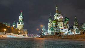 Moscow Kremlin timelapse hyperlapse with Spasskaya tower and Cathedral of St. Basil, Russia. Red Square in winter night stock footage