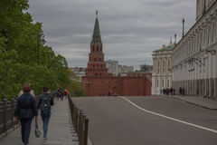Moscow Kremlin tourists walking pavement summer watch tower Stock Images