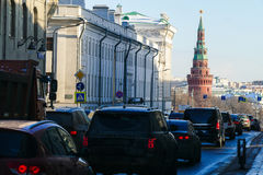 Moscow Kremlin Tower. And the flow of cars in Moscow stock photography