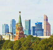Moscow, Kremlin tower and skyscrapers Royalty Free Stock Photography