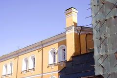 Moscow Kremlin tower under renovation. Blue sky background. Royalty Free Stock Photo