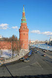 Moscow Kremlin tower and wall. Cars drive along the Moscow river embankment. Royalty Free Stock Images