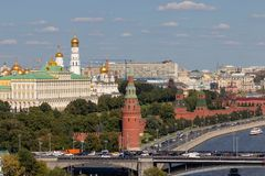Moscow Kremlin with towers. Assumption Cathedral, in the Kremlin. Grand Kremlin Palace. The road near the Kremlin wall and the embankment near the river stock images