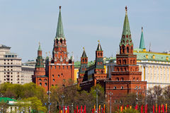 Moscow Kremlin towers cityscape over blue sky Stock Images