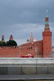 Moscow Kremlin. UNESCO World Heritage Site. Red touristic bus. Royalty Free Stock Photo