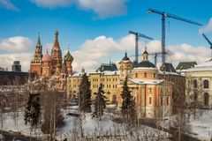 Spasskaya tower and St. Basil`s cathedral from Zaryadye Park. Moscow Kremlin. View of Spasskaya tower and St. Basil`s cathedral from Zaryadye Park stock photo