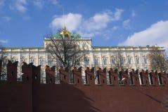 Moscow Kremlin wall at a sunny day. Blue sky background. Moscow Kremlin wall detail at a sunny day. Blue sky background. Grand Kremlin palace. Color photo Stock Photography