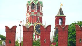 The Moscow Kremlin wall and famous Spasskaya tower clock. Telephoto lens dolly shot stock footage
