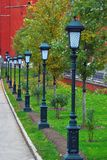 Moscow Kremlin wall and street lights in Alexander's garden. Royalty Free Stock Photos
