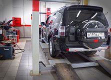 MOSCOW, MAR,02, 2017: Car automobile at wheel alignment maintenance works repair at automotive service center workshop. Technical. Maintenance wheel alignment Royalty Free Stock Photos