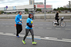 Moscow Marathon. MOSCOW - SEPTEMBER 25, 2016: Many people run on the streets of Moscow. They participate in Moscow Marathon, free public international sport Royalty Free Stock Photography