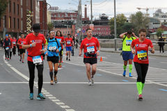 Moscow Marathon. MOSCOW - SEPTEMBER 25, 2016: Many people run on the streets of Moscow. They participate in Moscow Marathon, free public international sport Royalty Free Stock Photo