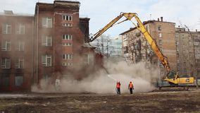 MOSCOW - MARCH 25, 2015: excavator demolishes building 205 schoo stock footage