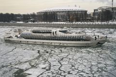 Moscow - March 3, 2018. Moscow pleasure craft sailing along the Moscow-River covered with a broken ice in early spring. Moscow - March 3, 2018. Moscow pleasure Royalty Free Stock Photography