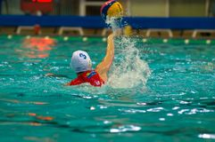 Throw the ball. MOSCOW - MARCH 23: Unidentified players in action semifinal LEN Trophy at a water-polo game between SKIF CSP Izmailovo� Moscow vs Uideks Donk Royalty Free Stock Photos