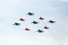 MOSCOW - MAY 9: Aerobatic demonstration team Swifts on Mig-29 Stock Images