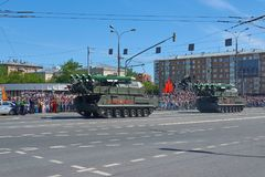 MOSCOW, MAY, 9, 2018: Great Victory holiday parade of Russian military vehicles air defence missile tank BUK M2. Tanks on city str. Eets and celebrating people stock images