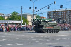 MOSCOW, MAY, 9, 2018: Great Victory holiday parade of Russian military vehicles air defence missile tank BUK M2. Tanks on city str. Eets and celebrating people royalty free stock photo
