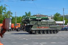 MOSCOW, MAY, 9, 2018: Great Victory holiday parade of Russian military vehicles air defence missile tank BUK M2. Tanks on city str. Eets and celebrating people stock image
