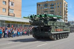 MOSCOW, MAY, 9, 2018: Great Victory holiday parade of Russian military vehicles air defence missile tank BUK M2. Tanks on city str. Eets and celebrating people stock photography