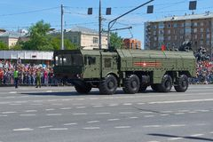 MOSCOW, MAY, 9, 2018: Great Victory holiday parade of Russian military vehicles air defence missile tank Iskander M 9K72. Tanks on. City streets and celebrating stock photography