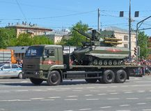 MOSCOW, MAY, 9, 2018: Great Victory holiday parade of Russian military vehicles. Radio control battle tank Uran-9 on truck. Celebr. Ating people in the Stock Photos