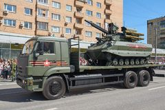 MOSCOW, MAY, 9, 2018: Great Victory holiday parade of Russian military vehicles. Radio control battle tank Uran-9 on truck. Celebr. Ating people in the Stock Image