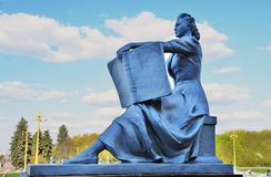 A woman holding a book. MOSCOW - MAY 04, 2019: Sculpture of a person holding a book, decoration on the street, by the Main building of Moscow State University in royalty free stock photography
