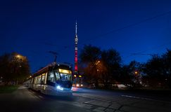 MOSCOW, MAY, 9, 2018: View of russian modern tramway at end station with front lights and TV tower Ostankinskaya bashnya Ostankin royalty free stock photo