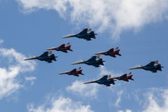 MOSCOW - MAY 5, 2015: warplanes fulfill aerobatics ready for the Stock Photography